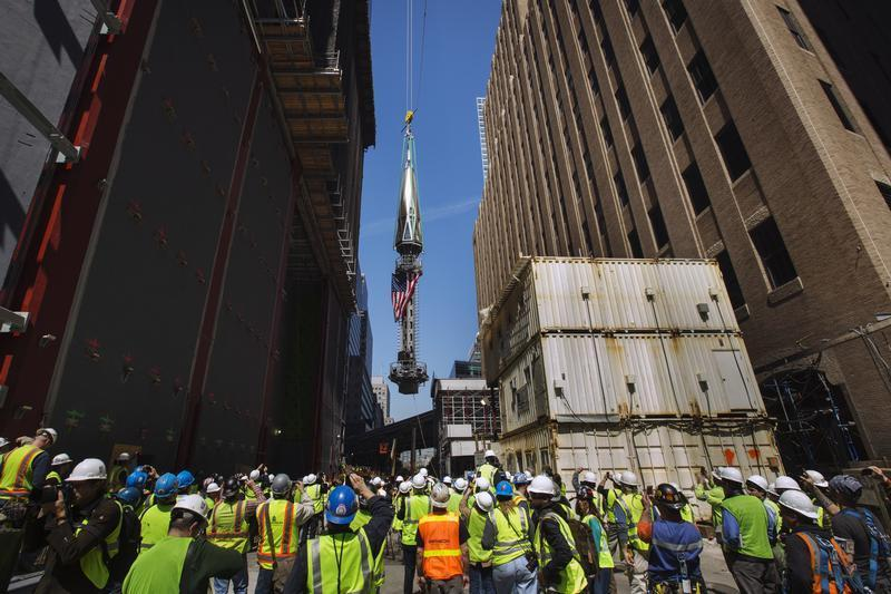 Photo Gallery: World Trade Center nears completionCrane operators hoist the final pieces of the spire atop One World Trade Center in New York.