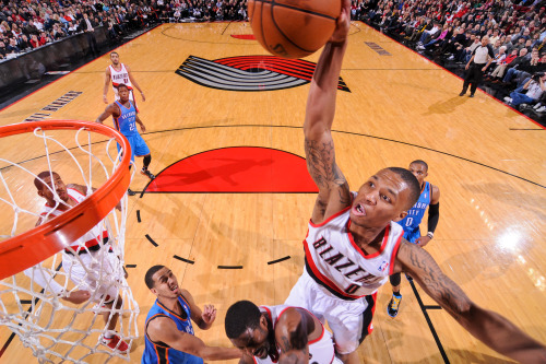 nba:  Damian Lillard of the Portland Trail Blazers rises for a dunk against the Oklahoma City Thunder on January 13, 2013 at the Rose Garden Arena in Portland, Oregon. (Photo by Sam Forencich/NBAE via Getty Images)