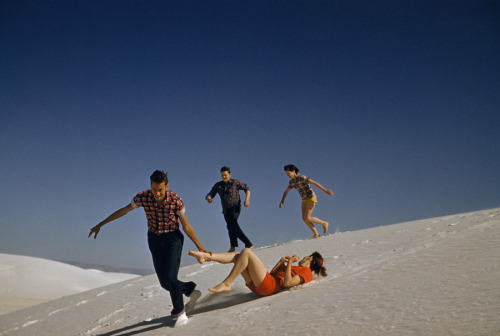 natgeofound:  Teenagers run and play on large white sand dunes in New Mexico, 1957.Photograph by J. Baylor Roberts, National Geographic