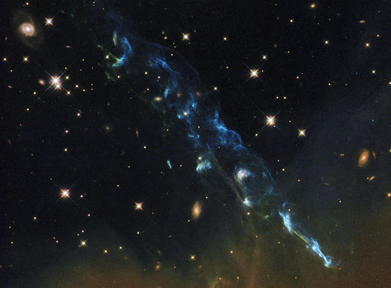 Day 19 of the 2012 Hubble Space Telescope Advent Calendar, one of 25 photos (eventually).  Herbig-Haro 110 is a light-year-long geyser of hot gas from a newborn star that splashes up against and ricochets from the dense core of a cloud of molecular hydrogen. This image was taken with Hubble's Advanced Camera for Surveys in 2004 and 2005 and the Wide Field Camera 3 in April 2011. (NASA, ESA, and the Hubble Heritage Team, STScI/AURA)