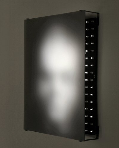 Jim Campbell Portrait of a Portrait of Harry Nyquist 2000Pixels: 192 LEDs. Image: 28 x 36 cm. Depth: 256 levels. This work consists of a matrix of 12 x 16 (192) white LEDs, which display a portrait of the well-known engineer who was involved in analog-to-digital conversion theory. The portrait cycles through a sequence of random noise. This image was taken from an obituary photograph. (J.C.)  (via Jim Campbell : Explorations of Meaning in Quantized Information)