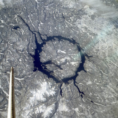 The Manicougan Crater in northern Canada is one of the largest impact craters known on Earth. The impact occurred around 210 million years ago at the end of the Triassic period and may have caused a mass extinction that killed around 60 percent of all species. Though the crater has mostly eroded, Lake Manicougan outlines what is left of the 43-mile wide impact structure. The asteroid that created the crater is thought to have been about three miles wide. Today the lake is a reservoir and popular salmon fishing location.