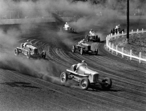 natgeofound:  Race cars roar around the track at the Iowa State Fair in 1938.Photograph by J. Baylor Roberts, National Geographic