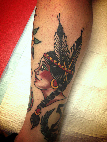 girl on side of calf. face profile stencilled, hair feathers etc freehanded on.