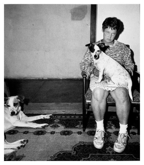okuparc:  Woman and dogs, 1994. Roger Ballen.
