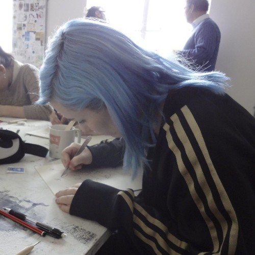 Me at the print workshop we had at SSU during our class trip to London :D In the photo I'm cutting out lines/sections in cardstock and whatever was cut out would end up not getting color on it. I've never done this kind of printing before and it was so much fun!