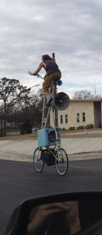 This guy was just pedaling along the highway in Bastrop, blaring chart-topper pop music from the 1980's on his homemade speakers. My questions were (1) how is he going to break when we reach the stoplight and (2) how does he climb down? Neither of my questions were answered.