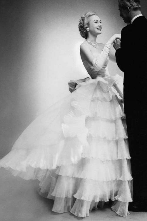 theniftyfifties:  Model wearing an evening gown by Balenciaga for Vogue, 1951,