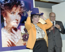 culdigital:  Title: [Elizabeth Taylor with purple cowboy hat at Neiman Marcus store, Dallas]   Creator: J. Allen Hansley Part Of: J. Allen Hansley photographsDate: October 1987 Description: Elizabeth Taylor at Neiman Marcus store, North Park, Dallas. Taylor was promoting her fragrance, Passion. Richard Marcus, right. Physical Description: 1 negative: safety film, color; 35 mm.  File: ag2006_0009_05_47_taylor_2926_33_opt.jpg              Rights: Please cite Southern Methodist University, Central University Libraries, DeGolyer Library when using this image file. A high-quality version of this file may be obtained for a fee by contacting degolyer@smu.edu. For more information, see: http://digitalcollections.smu.edu/u?/tex,318 View Texas: Photographs, Manuscripts, and Imprints: http://digitalcollections.smu.edu/all/cul/tex/