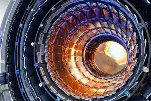 "Man Arrested at Large Hadron Collider Claims He's From the Future     A would-be saboteur arrested today at the Large Hadron Collider in Switzerland made the bizarre claim that he was from the future. Eloi Cole, a strangely dressed young man, said that he had travelled back in time to prevent the LHC from destroying the world.      The LHC successfully collided particles at record force earlier this week, a milestone Mr Cole was attempting to disrupt by stopping supplies of Mountain Dew to the experiment's vending machines. He also claimed responsibility for the infamous baguette sabotage in November last year.      Mr Cole was seized by Swiss police after CERN security guards spotted him rooting around in bins. He explained that he was looking for fuel for his 'time machine power unit', a device that resembled a kitchen blender.      Police said Mr Cole, who was wearing a bow tie and rather too much tweed for his age, would not reveal his country of origin. ""Countries do not exist where I am from. The discovery of the Higgs boson led to limitless power, the elimination of poverty and Kit-Kats for everyone. It is a communist chocolate hellhole and I'm here to stop it ever happening.""      This isn't the first time time-travel has been blamed for mishaps at the LHC. Last year, the Japanese physicist Masao Ninomiya and Danish string-theory pioneer Holger Bech Nielsen put forward the hypothesis that the Higgs boson was so ""abhorrent"" that it somehow caused a ripple in time that prevented its own discovery.      Professor Brian Cox, a CERN physicist and full-time rock'n'roll TV scientist, was sympathetic to Mr Cole. ""Bless him, he sounds harmless enough. At least he didn't mention bloody black holes.""      Mr Cole was taken to a secure mental health facility in Geneva but later disappeared from his cell. Police are baffled, but not that bothered."
