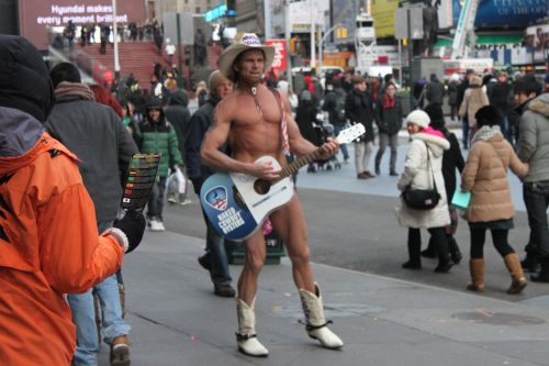 conspiretoreignite:  The Naked Cowboy plays in Times Square. 1.2.2013
