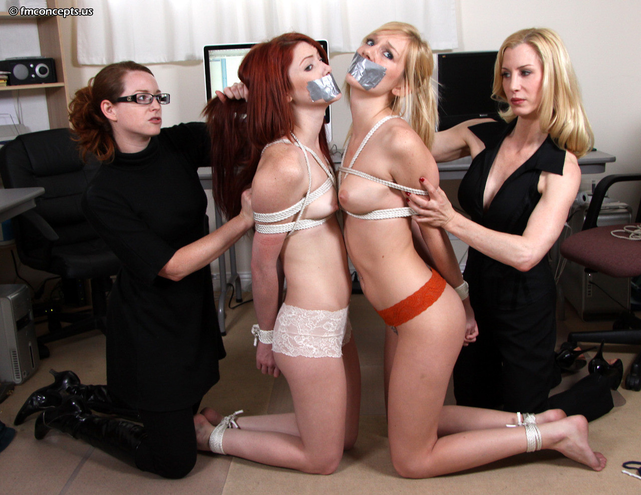 slaveauctions:  The two girls were the last ones in the office. Right before they left the slavers nabbed them. Their transition from secretaries to slaves started right away.