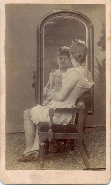 ca. 1870, [carte de visite portrait of a tattooed lady looking into a mirror] via  Syracuse University Library, Special Collections Research Center, Ronald G. Becker Collection of Charles Eisenmann Photographs