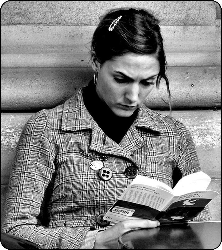 "La Liseuse - Reading Woman. Paris. A common view in Paris — people read a lot. On terraces, cafés, in the metro, the bus, on the train. Not so many magazines but serious books. The French are a very cultural and educated people. The book she reads received the ""Prix Goncourt"" (2005). ""Trois jours chez ma mère"" written by François Weyergans."