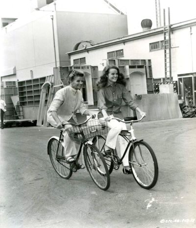 Katharine Hepburn and niece Katharine Houghton, riding bikes on set of Guess Who's Coming to Dinner?, 1967.