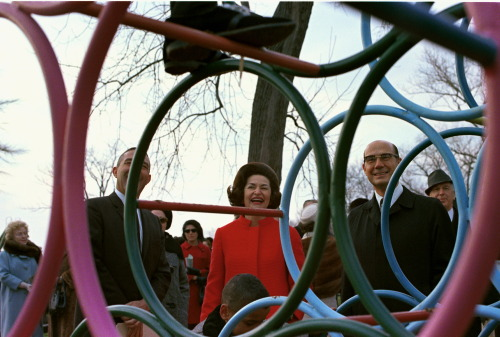 March 8, 1967. Lady Bird attends the dedication of playground and playground equipment donated by Mrs. Diaz Ordaz, the First Lady of Mexico, at Hains Point, in Washington, DC.  LBJ Library photo #C4649-30A, Sec. Stewart Udall, Lady Bird Johnson, and others. Public domain.