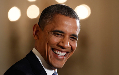 US President Barack Obama named TIME's Person of the Year Today: TIME magazine unveiled Barack Obama as the 2012 choice for its Person of the Year cover Wednesday. On Tuesday, the magazine's short list for the cover was revealed. In addition to Obama, those choices included Marissa Mayer, Mohammed Morsi, undocumented Americans, Bill and Hillary Clinton, Malala Yousafzai, Tim Cook, and Higgs Boson and Italian physicist Fabiola Giannati. The magazine's Person of the Year has been a topic of year-end debate ever since Charles Lindbergh was chosen the first Man of the Year in 1927. Read the TIME cover story here. Photo: US President Barack Obama smiles while addressing his 1st news conference since his reelection at the White House in Washington, November 14, 2012. (Reuters / Kevin Lamarque)