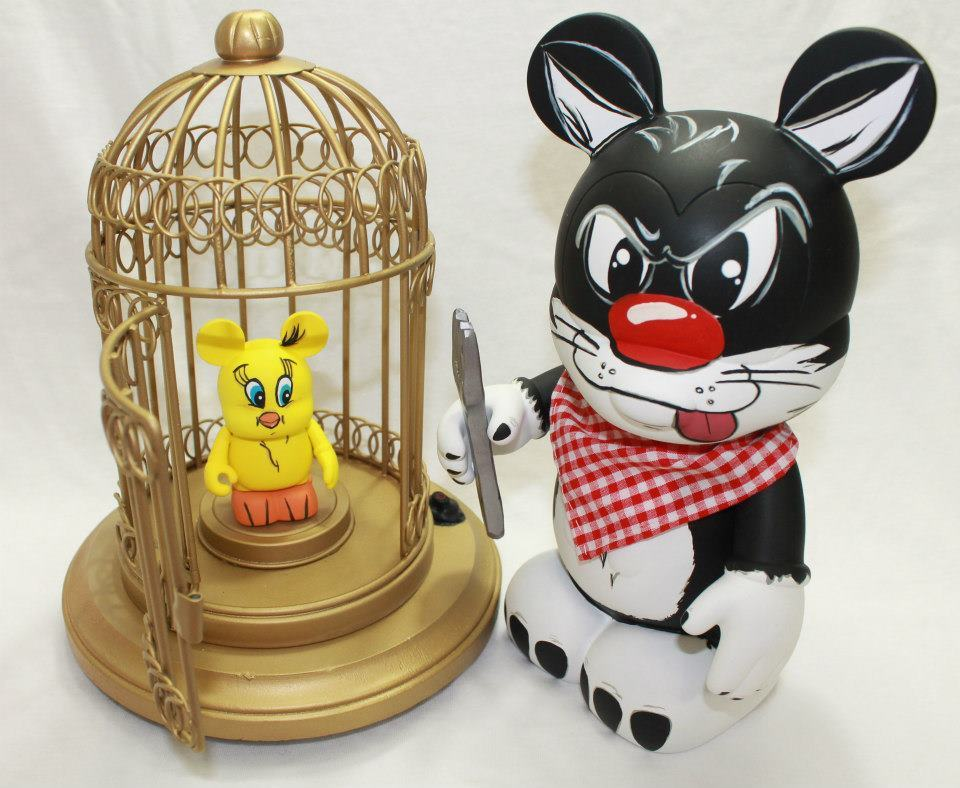 "Looney Tunes 9"" Sylvester & 3"" Tweety Bird Customs by Heather Kattelman, from Vinylmation Customations.  Gotta love the effort put into staging, it's fun to see the Vinylmations come to life through props.  Now for the real question, how is Tweety going to get out of this pickle? You can like the artist on Facebook to see more epic creations ranging from Star Wars characters to football oriented Super Bowl figures. via"