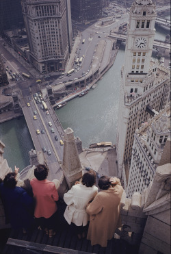 natgeofound:  Tourists atop the Chicago Tribune building look down on the Chicago River, the site of Old Fort Dearborn.Photograph by B. Anthony Stewart, National Geographic