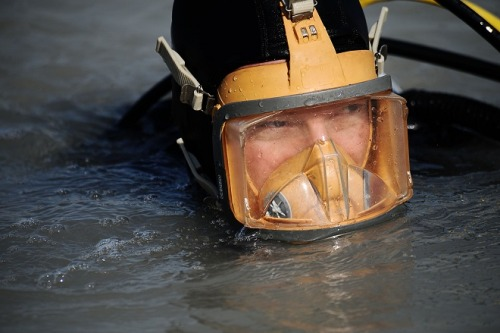 "Even casual divers know that diving too deep, or surfacing too quickly, can cause a host of complications from sickness to seizures and even sudden death. Now the Pentagon's scientists want to build gear that can turn commandos into Aquaman, allowing them to plunge into the deeps without having to worry as much about getting ill. (Orange and green tights sold separately.) According to a list of research proposals from the U.S. military's blue-sky researchers at Darpa, the agency is seeking ""integrated microsystems"" to detect and control ""warfighter physiology for military diver operations."" Essentially it comes down to hooking divers up to sensors that can read both their bio-physical signs and the presence of gases like nitric oxide, which help prevent decompression sickness, commonly known as ""the bends."" If those levels dip too low, the Darpa devices will send small amounts of the gases into divers' lungs to help keep them swimming.  More @ Danger Room!"