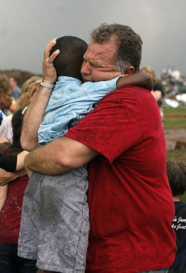 A teachers hugs a child at Briarwood Elementary school after a tornado destroyed the school in south OKC Oklahoma City, OK, Monday, May 20, 2013. Near SW 149th and Hudson. By Paul Hellstern, The Oklahoman - newsok