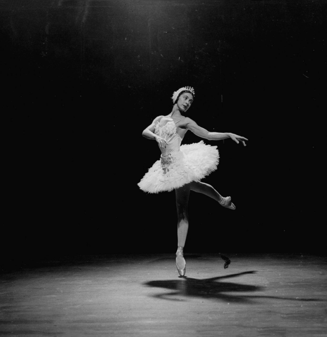 whodesignedit:  Ballerina Margot Fonteyn in White Costume Balanced on One Toe While Dancing Alone on Stage by Gjon Mili A beautiful poster print of ballerina Margot Fonteyn by Gjon Mili! She is widely considered the greatest classical ballet dancers of all time. Get this beautiful poster at AllPosters.