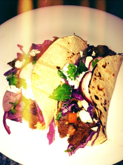Taco Night for yesterday's dinner!  - chipotle spice steak - red cabbage & radish slaw - corn & black bean salsa  - cojita cheese & sour cream  All in a corn tortilla. Olé.