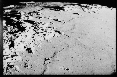 lighthouse: Surface of the Moon, photographed from Apollo 17, December 1972. 26°N 8°E. The smooth plain at right is the eastern Mare Serenitas. At left is the mountainous Promontorium Fresnel. Separated from this by a narrow channel is the southern point of the Montes Caucasus (top center). At extreme top left are the high ramparts of craters Autolycus and Aristillus. Frame 23930 from Nikon magazine XX (159). Image credit: NASA, c/o LPI.