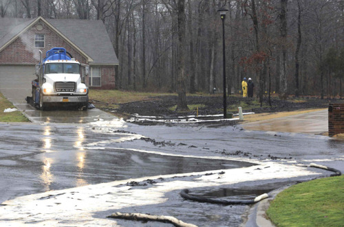 bylinebeat:  'Major Spill' After Exxon Pipe Ruptures in U.S. An Exxon Mobil crude oil pipeline ruptured near the town of Mayflower in the US state of Arkansas, spilling thousands of barrels of oil, the company said. Exxon shut the 50-centimetre Pegasus pipeline, which carries crude oil from Pakota, Illinois, to the Gulf Coast, after the leak was discovered on Friday afternoon. Exxon, which was hit with a $1.7m fine by regulators this week over a 2011 spill in the Yellowstone River, said a few thousand barrels of oil had been observed. [more] — Related: Read more on the Keystone Pipeline decision and the two tar sands spills that occurred this week. Photo Credit: (Reuters)  The spill is estimated to be at least 10,000 barrels in size. Pretty crazy stuff.