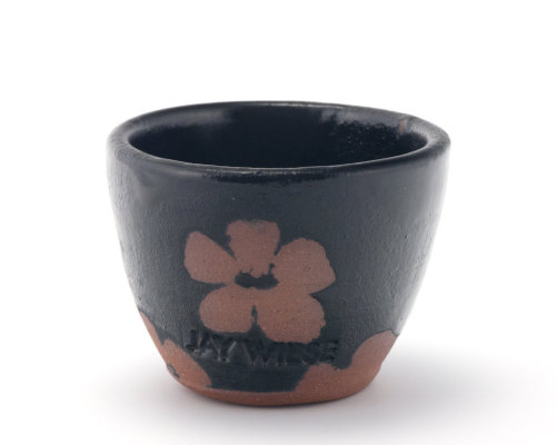 Black modern sake cup with unglazed flower pattern by Jay Wiese, via Etsy