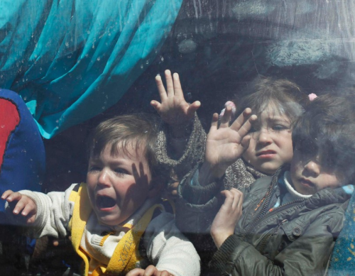 Palestinian children hoping to cross into Egypt wait inside a bus at the Rafah crossing between Egypt and the southern Gaza Strip, March 31, 2014. Egyptian authorities partially reopened Rafah border crossing, Gaza's main window to the world, on Saturday for three days after 50 days of its closure, Palestinian border officials said. Since the overthrow of Egyptian President Mohamed Mursi in July 2013, the authorities have largely kept the crossing closed, worsening the humanitarian crisis in the coastal enclave. (Photo: Ibraheem Abu Mustafa / Reuters)