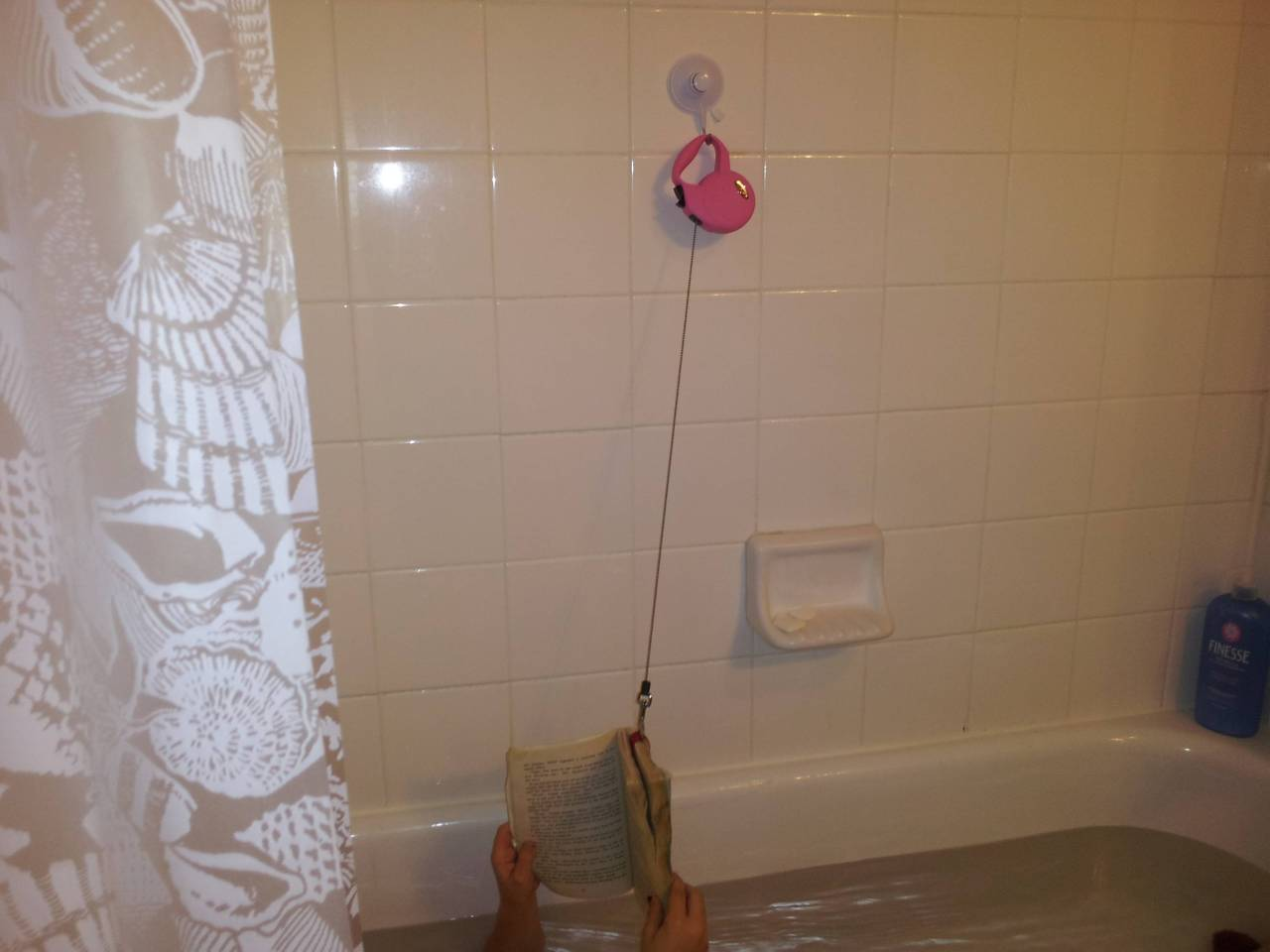 alegbra:  valerieparker:  writers-bloc:  Never drop a book in the bath again! An 8 year old's invention.   that eight year old is the chosen one  are we gonna ignore the fact that the book is completely soaked in water