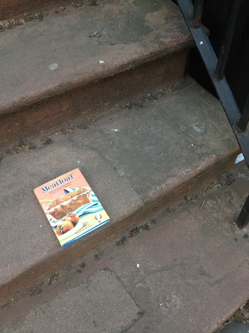 "Interpreting the stoop books of Brooklyn:""I like to think this book is the sign of a heartfelt and long-planned conversion to vegetarianism by a middle-aged optometrist named Richard. It's not so much the ethical concerns of meat, though he's not blind to those, but Richard has just reached a certain age where he feels he needs to work harder to maintain the same level of health he's been taking for granted, and giving up meat is a part of that larger struggle.But this is Brooklyn. No, some kid bought this book ironically and got bored of it, is all."""