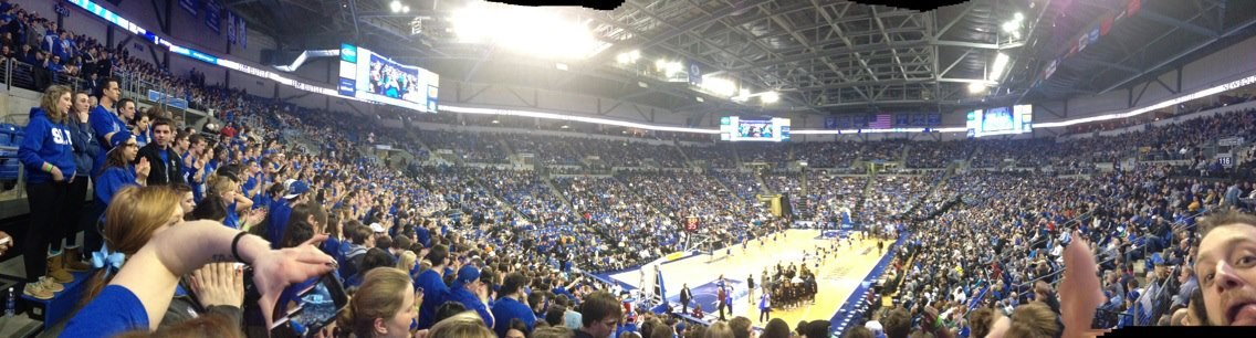 BILLIKEN NATION BLUEOUT The game was wild. Our bodies shaking with excitement as the Bills were up by 20 points against VCU who was previously the #1 ranked team in the A10 Conference, but that all changed when the buzzer went off indicating set, match, and game. The Bills are now the #1 ranked team in the A10 conference which is such a thrill!It was truly an amazing experience and I think most Billikens would agree that the energy from our community and the constant support for our Bills was a major part of the game. Nevertheless, the Bills will be taking on Butler this Friday as visitor and it will truly be the most difficult game of the season. In the previous game, SLU defeated #9 Butler which was also a great game and this Friday will be sort of a re-match for the two teams. I'm proud to be a Billken not only because of our amazing men's basketball team, but the fact that this wonderful community constantly supports each other at so many diverse events on campus. If I could, I would go to every single event! That's a fact. Until next time everyone,BE A BILLIKEN. ~Nicole(Photo Courtesy of: Megan Danzo)