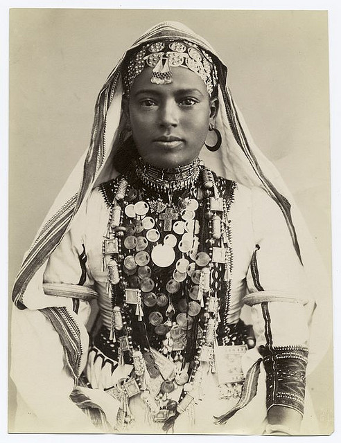 [Girl in ceremonial dress.] by New York Public Library on Flickr.