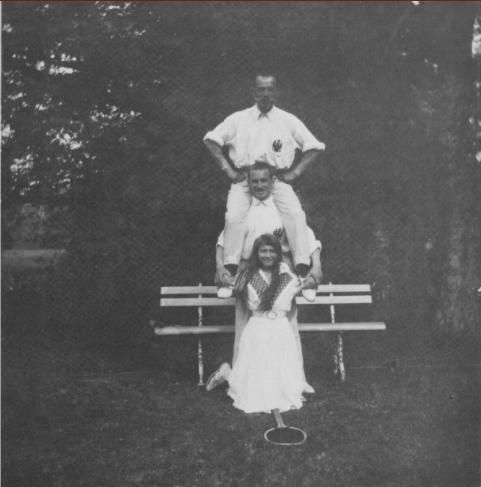 Nicholas II and Grand Duchess Anastasia with an officer taking a break from tennis in the Crimea: 1914.