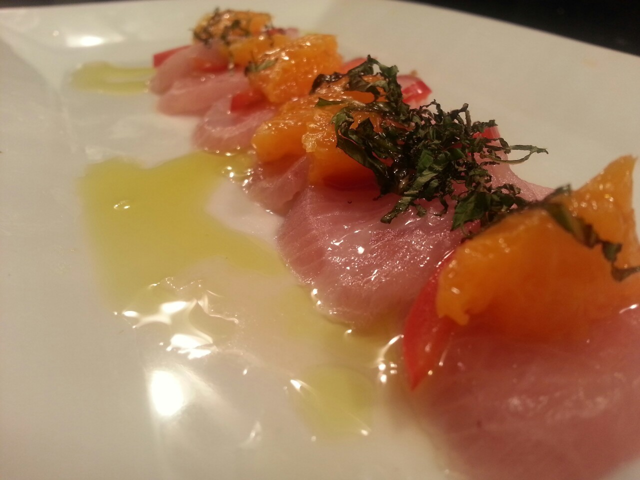 Yellowtail with tangerine, mint, pickled jalapeno, and lemon.