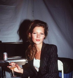 thesatinjacket:  young Kate Moss with champagne and a cigarette