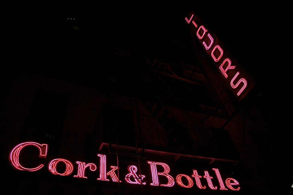 "RIP Cork & Bottle(on First Avenue between E 63rd & E 64th Streets in the Upper East Side) Sad, sad news shared by Gary Wright: The Cork & Bottle neon was scrapped and replaced by back-lit plastic lettering this morning. This (together with Goldberger's Pharmacy) was one of the first New York neon signs I photographed and those two signs were really what inspired the whole project. I want to believe it's not true, but I know I'll have to see it for myself on Monday morning on the way to work. That amazing ampersand!  That steadfast letter C! The classic vertical Liquors!  There was also a tiny unlit ""LTD"" to the right of Bottle that I loved — a secret little addition I imagined getting relit some day. As I've said before, pink is not a color I like much in most of life, but pink neon is really wonderful. The sign was always a tough one to photograph, with signs, trees, traffic, and the awning in the way, so I don't feel like I fully did it justice, but it will have to do. RIP Cork & Bottle neon, you will be missed. New York is a darker place without you."
