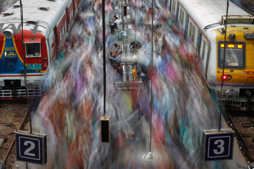 Commuters disembark from crowded suburban trains during the morning rush hour at Churchgate railway station on World Population Day in Mumbai on July 11. According to a 2011 census conducted by the government of India, Mumbai has a population of more than 12 million with an estimated population density of about 20,482 persons per square kilometer. (Vivek Prakash/Reuters) 2012 Year in Pictures: Part II