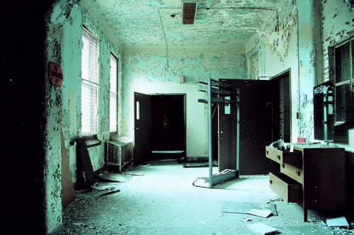 abandonedography:  Hospital hallway shot on expired 35mm Kodak Elite Chrome by Matt Allouf  Expired 35mm. Wholyshit..