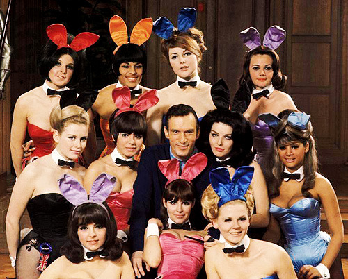 lanallure:  Hugh Hefner poses with Playboy Club bunnies, 1966.