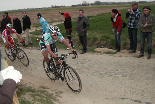 Niki Terpstra & Luca Paolini | Paris-Roubaix 2012 on Flickr.Via Flickr: Paris–Roubaix is a one-day professional bicycle road race in northern France near the Belgian frontier. From its beginning in 1896 until 1967 it started in Paris and ended in Roubaix (hence the name); since 1968 the start city has been Compiègne (about 60 kilometres (37 mi) north-east from Paris center) whilst the finish is still in Roubaix. Famous for rough terrain and cobblestones (setts),[n 1] it is one of the 'Monuments' or Classics of the European calendar, and contributes points towards the UCI World Ranking. It has been called the Hell of the North, a Sunday in Hell (also the title of a film about the 1976 edition of the race), the Queen of the Classics or la Pascale: the Easter race.[1] The race is organised by the media group Amaury Sport Organisation annually in mid-April. First run in 1896, Paris–Roubaix is one of cycling's oldest races. It is well known for the many 'cobbled sectors' over which it runs, being considered, along with the Ronde van Vlaanderen and Gent–Wevelgem to be one of the cobbled classics. Since 1977, the winner of Paris–Roubaix has received a sett (cobble stone) as part of his prize.[2] In recent years, the terrain over which Paris–Roubaix runs has led to specialized bikes, with unique frames and wheels, being used. Wheel punctures and other mechanical problems are extremely common because of this terrain, and often play a part in who is able to ultimately make it to Roubaix with momentum. Despite the high esteem with which the race is seen, some notable cyclists throughout history have regarded the race as a joke because of its difficult conditions. The race has also seen several controversies over the years, with many seeming winners of the race disqualified for various reasons. The course is maintained by Les Amis de Paris–Roubaix, a group of fans of the race formed in 1983. The forçats du pavé seek to keep the course as safe as possible for riders while maintaining its difficulty.