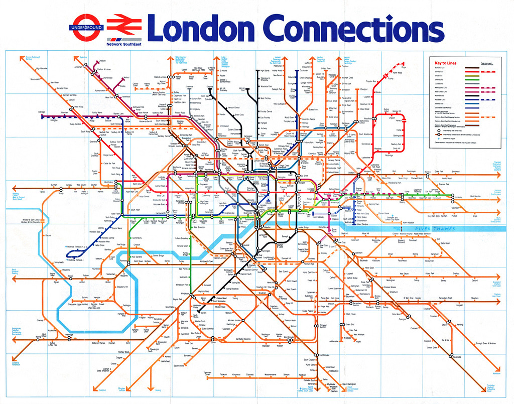 Historical Map: London Connections, 1988 The reverse side of the British Rail Network SouthEast map, showing the detailed view of the area surrounding London. While this map is designed in a very similar style (at the same time, by the same people) to the regional map, I feel it's slightly less successful for a few reasons. The inclusion of the London Underground introduces many more colors to the map, which instantly makes it feel much busier. After using all these familiar and well-established colours for the Underground, there really aren't many colours left to use for the main line/Network SouthEast routes. So they get saddled with orange, a very vivid, powerful colour that visually dominates the map, especially south of the Thames. Interestingly, the London Overground — a service which has largely been formed from parts of these old main line routes — also uses orange as its route colour: is this map the origin of that designation? Other points of interest: The Docklands Light Railway, opened the previous year, is shown but has not yet acquired its distinctive teal route colour. The Waterloo & City Line (a very short line between Waterloo and Bank stations) is still part of British Rail, not the Underground. See also this British Rail map from 1965 (May 2012, 4.5 stars) that covers a very similar area but omits the Underground. Our rating: A fine piece of work that skillfully incorporates a lot of information, but not as excellent as its sibling. Three stars.   (Source: smallritual/Flickr)