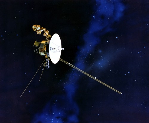 The Grand Tour Continues Over the past 35 years the Voyager probes have been an inspiration to many, a human project spanning the generations. Originally envisioned as a grand tour of the planets, the mission expanded to encompass the outer reaches of the solar system and beyond into interstellar space. A rare planetary alignment facilitated the use of the gravity assist technique. This dance among the planets allowed the probes to steal kinetic energy, accelerating to extraordinary speeds; they will travel a further 1000 km in the time it takes you to read this article. The venerable spacecraft continue to provide new revelations, such as the discovery in 2011 of 'magnetic bubbles' in the heliosheath separating the Sun's sphere of influence from the interstellar medium. It now appears that in the wrinkled and twisted fringe of the Sun's magnetic field, magnetic reconnection forms self-contained regions more than 100 million km across, with only tenuous connections to the broad structure of the solar magnetic field. A 'foam' of magnetic bubbles may even form a partial barrier, protecting the solar system from bombardment by cosmic rays. It is a testament to the robustness of the 1970s era technology that most instruments are still available for use, although many have been disabled to conserve energy. The onboard radioisotope thermoelectric generators are projected to keep some instruments functioning until 2025. What then? In 40,000 years, Voyager 1 will pass within 1.6 light years of the star Gliese 445. With no power and hence no electromagnetic emissions, it seems a forlorn hope that this tiny spec in a vast cosmos will ever be discovered by another civilisation. But just in case, both probes carry with them the Voyager Golden Record, bearing messages from J.S. Bach, Chuck Berry and others, painting a picture of humanity for whomever they might encounter. Guest article by Jeffrey Philippson