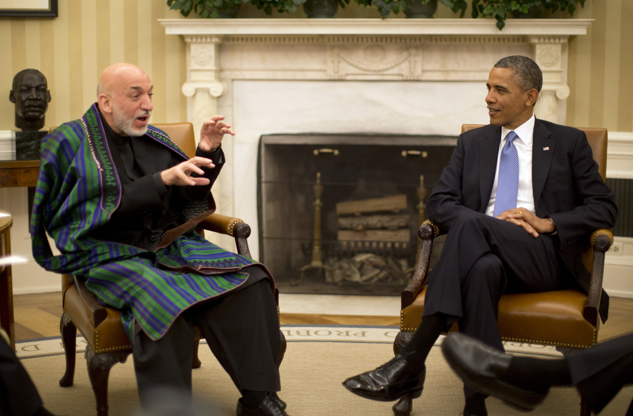U.S. President Barack Obama meets with Afghanistan's President Hamid Karzai in the Oval Office of the White House in Washington, January 11, 2013. REUTERS/Jason Reed LIVE COVERAGE: Around-the-clock news on U.S. politics