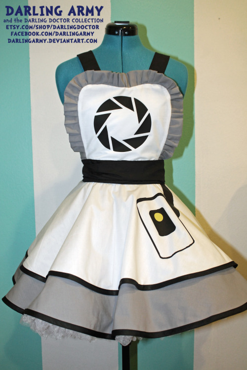 GLaDOS -Portal- Cosplay Pinafore by Darling Army This will be available for commission when my new store opens in May —> The Darling Doctor Collection by Darling Army  Finally a new design! GLaDOS will be premiering on the runway at the Tomo Neko Maid Cafe during their Darling Army Fashion Show! I have been waiting sooooo long for this one! All of the details are in vinyl, so it's super durable. It will walk down the runway with Companion Cube =3 So excited to have finally finished it!