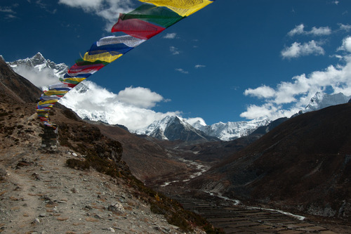 Photo of the Day: 'Island Peak' by Hugh Chaloner.  Trekking above Pheriche, you start to see Island Peak. At just over 6000m it's still two vertical kilometres shorter than Everest, but even still, it's a force to be reckoned with. In the valley below you can see how tough life is for the locals, scratching out sustenance from the barren ground, so high up that not much will grow.  The mountain itself is mostly non-technical, just a very tough slog but the ascent up to the headwall is steep and made in the dark thankfully, because if you could seethe drop you mightn't be so eager to get up there.   This photo is available to buy from only €25 at http://www.lokofoto.com/photos/657