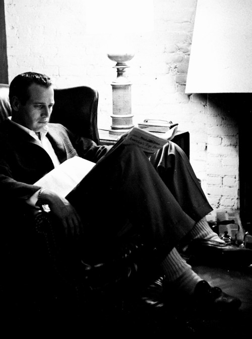 Paul Newman reading a newspaper
