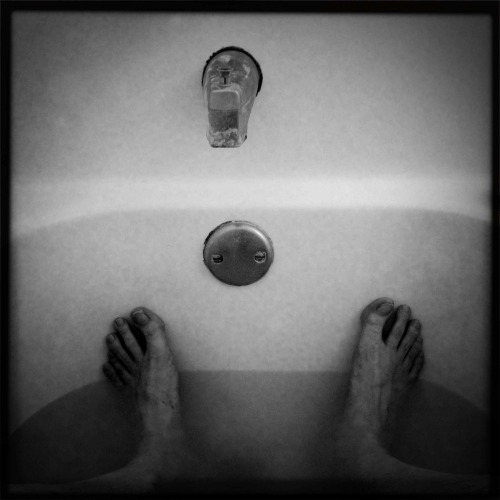 """Bath Tub Feet""   For your daily dose of Hipstamatic ya my feet.  Some may find this a interesting shot some may say who cares.. Hipstamatic 261 with John S lens, Super Black Key film, no flash. Visit my blog at Http://www.hipstamaticpics.com"